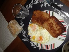 Sanjacobas (fried ham and cheese patties), eggs, and bread