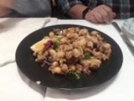 Fried calamari with leafy greens and lemon at La Gloria de Montera restaurant