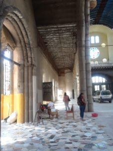 Passing through one of the large interior arches of the cathedral