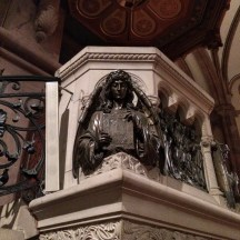 This angel holding the Bible is on the pulpit in St. John's.
