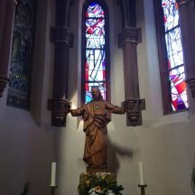 This impressive, life-sized wood carving of Jesus is in Sacred Heart.