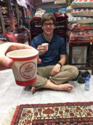 Danny enjoying a cup of karak in the back of Shah's shop