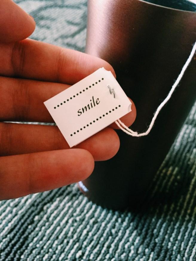 """My tea bag says """"smile"""" :)"""