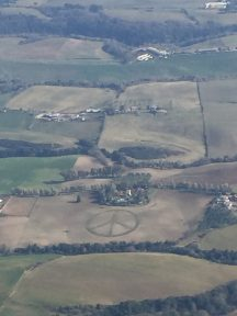 Peace sign mowed in farm field
