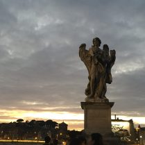 One of the many statues along the bridge crossing the Tiber River.