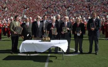 Trophy presented on football field