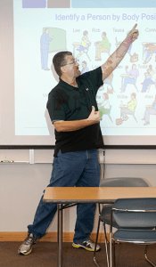 Symansky instructs his class through a visual approach, which consists of acting out lessons or drawing. Photo illustration by Anya Ivantseva