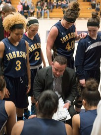 Coach Ben Conrad explains the next play to the team during a timeout in the final game of the NJCAA National Women's Basketball Tournament. Photo by Julia Larberg