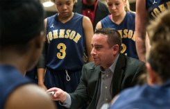 Coach Ben Conrad explains the play he wants to run during the final NJCAA tournament game. Photo by Mike Abell