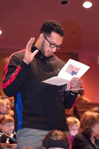 President Joe Sopcich congratulating JCCC student Hassan Fikri on becoming an American citizen. Photo by Anya Ivantseva.