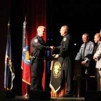 Recruit Jonathon Guthrie is congratulated for completing the program. Photo by Lance Martin