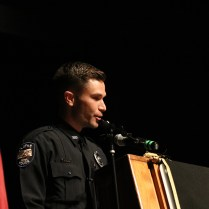 Recruit Paul Bender speaks before his class. Bender also recieved the Rick Staples Marksmanship Award. Photo by Lance Martin