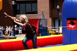 A representative for UPS laughs as she plays one of the many games at last year's Cav Kickoff. This year's event will take place from 10 a.m. to 2 p.m. Wednesday in Fountain Square Plaza. Ledger file photo