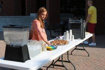 """Kayla McDougald (Student Activities Ambasador) greets students and offers free muffins and coffee for JCCC's """"Cup of Joe with Joe"""". The slogan is refering to JCCC's President Dr. Joe Sopcich."""