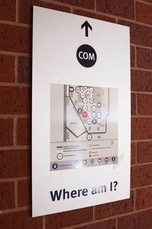 """Quick building reference maps can be found throughout campus. Maps are equipped with a """"you are here"""" red dot that can help students identify their current position in the building."""