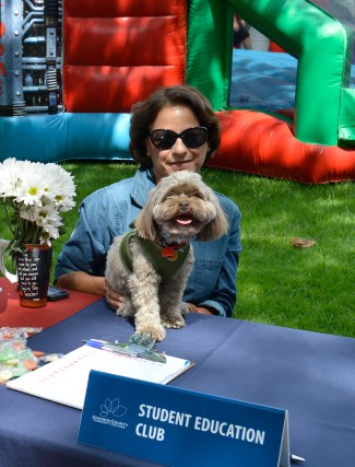 Student education adviser Michelle Salvato with mascot Oliver. Photo by E.J. Wood.