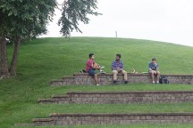 Students relax on the hill outside COM at lunchtime