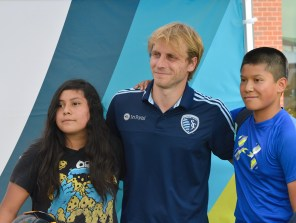 Seth Sinovic poses for pictures with young fans.