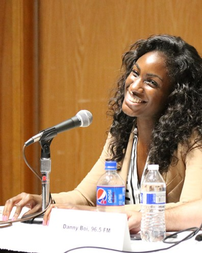 Ivani Bing from 95.7 FM is tuned into the questions posed by the moderators. Photo by Lance Martin.