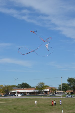 Fest-goers flying kites in front of the Regnier Center. Photo by E.J. Wood.