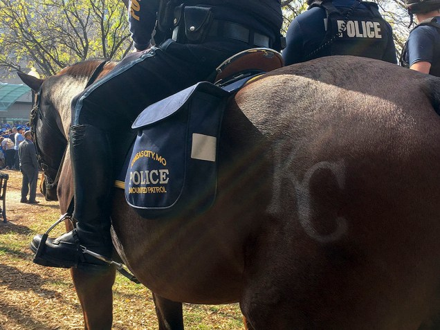 Mounted Kansas City police officers rode on Royals decorated horses and were on full alert throughout the parade. Photo by Pete Schulte.
