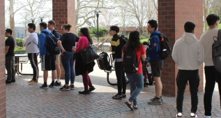 People were in line to get some free food while enjoying the nice weather with their friends. Photo by: Jennifer Tharp, The Campus Ledger.