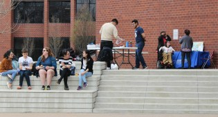 Students enjoying each other's company and looking at the various tables that were set up for International Day. Photo by: Jennifer Tharp, The Campus Ledger.