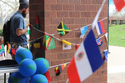 Flags from countries all around the world were wrapped around columns and hung up in the courtyard area for International Day. Photo by: Jennifer Tharp, The Campus Ledger.