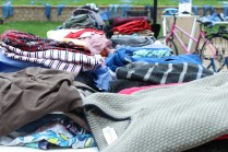 The tables were filled with a variety clothes from shirts to jeans that were being sold in the courtyard for Earth Day. Photo by: Jennifer Tharp, The Campus Ledger.