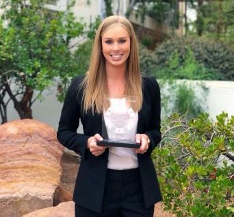 Rebecca Quade with Best Oral Advocate Award in Vegas