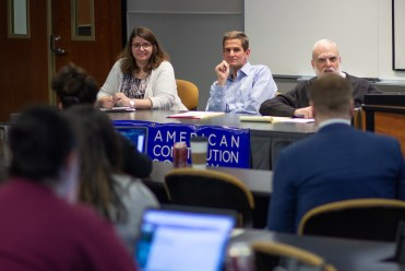 Chicago-Kent Constitutional Law professors answer questions about Impeachment at a student organization panel.