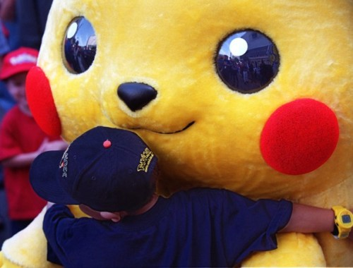 "Daniel Osugi, 7, of Long Beach, Calif., hugs an oversized Pokemon character known as ""Pikachu"" at the premiere of the new Warner Bros. animated feature, ""Pokemon The First Movie,"" Saturday, Nov. 6, 1999, at the Mann's Chinese Theatre in the Hollywood section of Los Angeles.  Pikachu is the main character of the animated adventure, based on the hit Japanese TV series and video game.  (AP Photo/Chris Pizzello)"