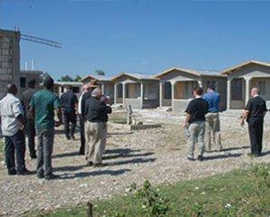 Haitians and Synod leaders view homes under construction in Leogane, in conjunction with the Jan. 14-15, 2012, dedication of three new Lutheran villages in Haiti. (LCMS Communications/Al Dowbnia)