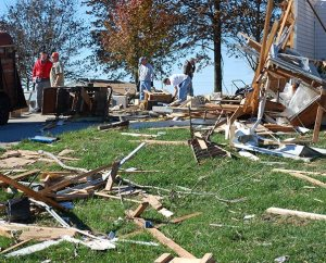 The Rev. Timothy Mueller (in red at left), pastor of St. John's Lutheran Church in New Minden, Ill., works with volunteers on Nov. 18 to clean up his tornado-damaged parsonage. (Bill Engfehr)
