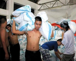 Volunteers load food packs bound for Christ Lutheran Church in Mahayag, Albuera, Leyte, at the compound of Our Savior Lutheran Church in Matina Aplaya, Davao City, Philippines, in late November. The food packs — purchased with LCMS disaster dollars — were distributed to families in Mahayag affected by Typhoon Haiyan. (LCP Disaster Response/JC Valeriano)