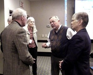 LCMS Director of School Ministry Terry Schmidt, third from left, talks with several members of the Synod's Board for National Mission (BNM) after his presentation at the board's Feb. 7-8 meeting. BNM members, from left, are Dr. Gary Quick, Martha Milas and Linda Stoterau. (LCMS Communications/Joe Isenhower Jr.)