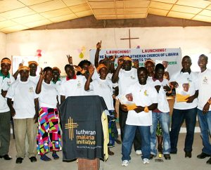 """Liberians celebrate the official launch of the Lutheran Malaria Initiative (LMI) in their West African country earlier this year. LMI is working through congregations and schools of the Evangelical Lutheran Church in Liberia to train pastors, teachers and volunteers who already have relationships in so-called """"last-mile,"""" or remote, communities. (Lutheran Malaria Initiative)"""