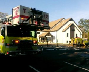A local firefighting unit responds to the April 20 two-alarm fire at Trinity Lutheran Church, Richmond, Va., that caused no injuries, but resulted in limited destruction and considerable smoke and water damage. (WTVR.com)