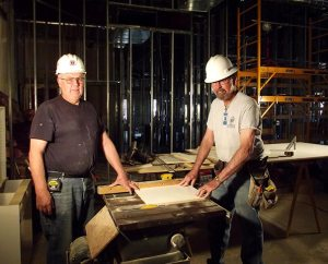 Don Michelson, left, of Munsing, Mich., and Rich Husfeld of Katy, Texas, members of LCEF's Laborers For Christ, are working for Christ Lutheran Church in Albuquerque, N.M., to expand its day-school facilities. Husfeld is the project manager there. (Lutheran Church Extension Fund)