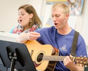 The Rev. Andrew Ratcliffe, pastor at St. John Lutheran Church, Seward, Neb., leads a July 29 institute workshop on the liturgical use of the guitar. (LCMS/Erik M. Lunsford)