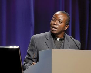 The Rev. Amos Bolay, president and bishop of the Evangelical Lutheran Church of Liberia and recipient of a Global Seminary Initiative scholarship, addresses the 2013 LCMS convention. (LCMS Communications)