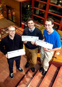Holding their $300 checks as first-place winners in the Chicago IEEEXtreme 24-Hour Programming Competition are, from left, Andrew Menke, Joseph Bayer and Nicholas Farley, Concordia University Chicago undergraduates who made up the winning team. (Concordia University Chicago/Emily Barrett)