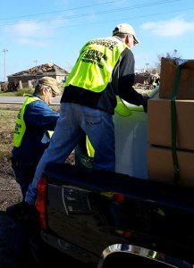 """Disaster response volunteers from the LCMS Texas District and Synod congregations pick up debris from the Dec. 26 tornadoes. """"People are sacrificing personal time in a desire to relieve the pain and confusion that results from such overwhelming devastation — all in the name of Christ,"""" said the Rev. Steven Misch, the district's disaster response coordinator. (David Ricks)"""