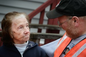 The Rev. Donald Love, pastor at Calvary Lutheran Church in Watseka, Ill., talks to Mini Kessinger, an 88 year-old flood victim and parishioner, while teams conducted a volunteer event for cleanup of flood-damaged homes on Saturday, Jan. 9, 2016, in Watseka. LCMS Communications/Erik M. Lunsford