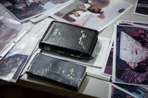 Translated Bibles lie on the table next to photographs of refugees helped by the Rev. Thomas Seifert, pastor of Paul-Gerhardt Gemeinde, a SELK congregation in Braunschweig, Germany.