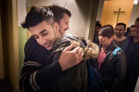 The Rev. Dr. Gottfried Martens hugs a refugee following Bible study.