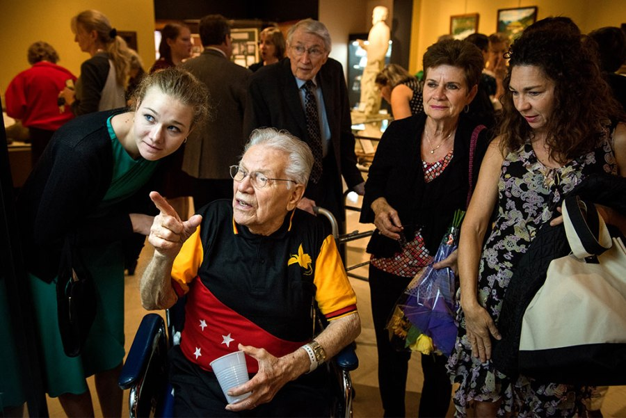 "The Rev. Dr. Otto C. Hintze Jr. browses artifacts with family, including his granddaughter, Ellie Hintze (left), during the Oct. 5, 2014, opening of Concordia Historical Institute's ""Bringing Christ to the Highlands"" exhibit. (LCMS/Erik M. Lunsford)"