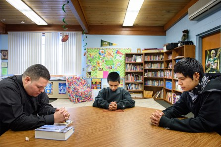 Vicar David Blas, left, mentors Jose Vazquez, center, and Gustavo Lozano on Jan. 29 at Immanuel Evangelical Lutheran School in Sheboygan, Wis.