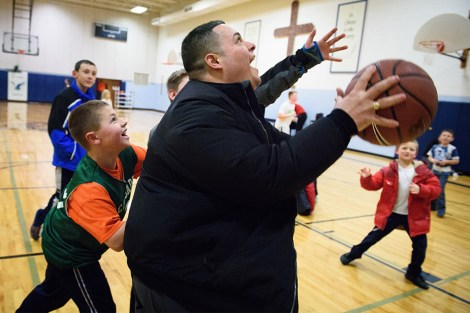 Vicar David Blas prepares to shoot in a small pickup game following a scheduled game between schools on Jan. 28 in Plymouth.