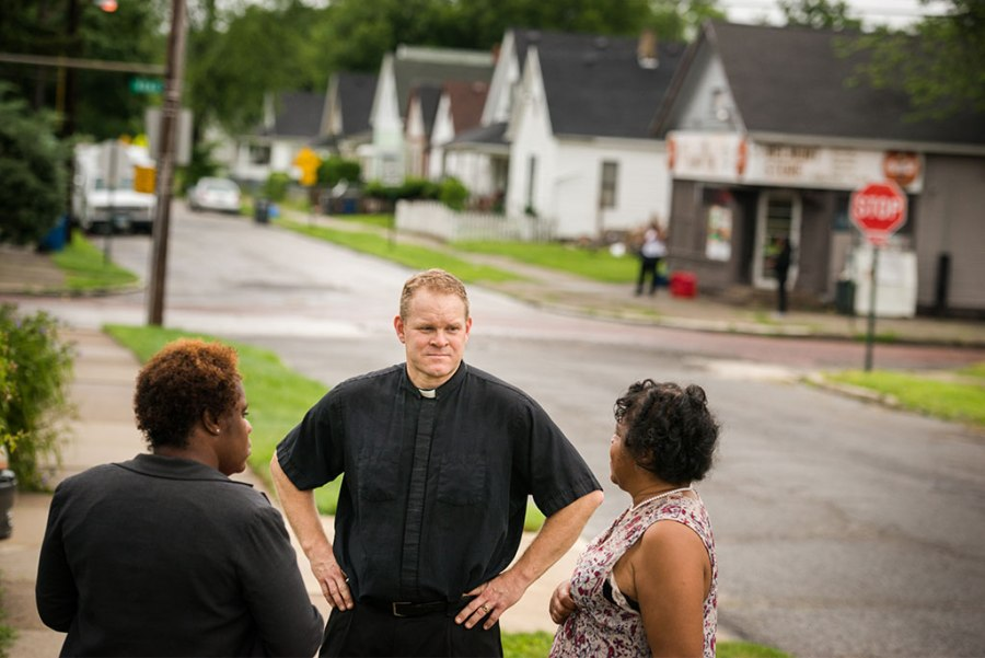 While conducting a survey last summer for a new church location in Toledo, Ohio, the Rev. Peter M. Burfeind talks with community advocate Alicia Smith (left) and a resident. Burfeind is an LCMS national missionary to that city and campus pastor at the University of Toledo. (LCMS/Erik M. Lunsford)